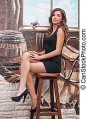 Brown hair beauty Side view of beautiful young woman sitting...