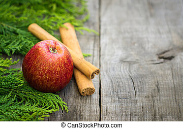 Red Apple with cinnamon sticks