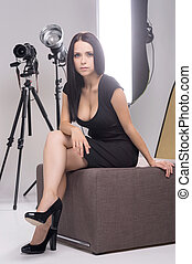 Model at photo studio. Beautiful young woman in photo studio