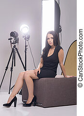Model at photo studio. Attractive young woman in photo studio