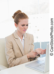 Businesswoman suffering from wrist pain in office - Young...