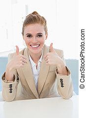 Elegant businesswoman gesturing thumbs up - Portrait of an...