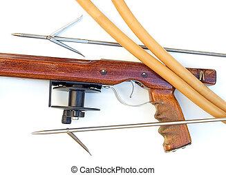 Wooden speargun - Handmade wooden speargun with equipment on...