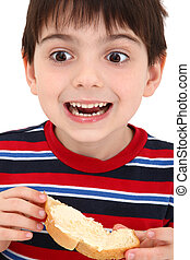 Boy Eating Toast - Adorable caucasian six year old boy...