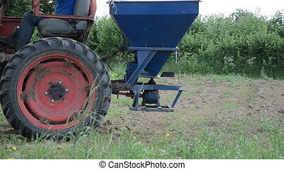 machine seed sow field - Follow retro tractor wheels and...