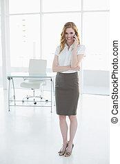 Elegant businesswoman using mobile