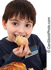 Boy Eating Chicken - Adorable six year old caucasian boy...