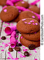 fresh chocolate cookies, coffee beans, pink ribbons and...
