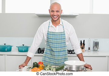 Smiling young man with vegetables i - Portrait of a smiling...