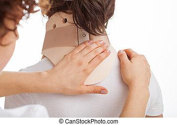Physician examining a neck - Female physician examining a...