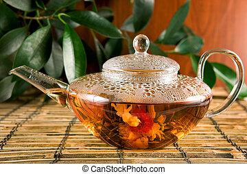 Flower tea in a glass teapot