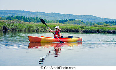 Woman With Safety Vest Kayaking Alone on a Calm River -...