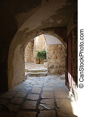 Ancient patio - Arch input in an ancient court yard in an...