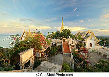 Tropical sunset on temple - Golden sunset on Prachuap Khiri...