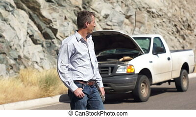 Stranded and Looking for Phone Sign - Caucasian man with his...