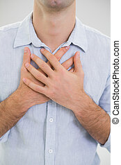 Mid section of a man with chest pain - Close up mid section...