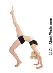 Fit woman doing the wheel pose with one leg raised - Full...
