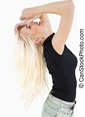 Side view of a cheerful beautiful casual blond over white...