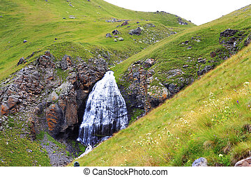 Waterfall Girlish Braids between the mountains of Northern...