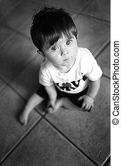 Little boy looking up - Sweet little boy sits on the floor...