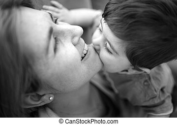 Kisses for Mommy - A mother enjoys a sweet moment with her...