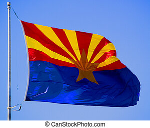 Arizona Flag - The state flag of Arizona flies in the sky