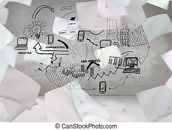 White paper in front of grey wall with graphic