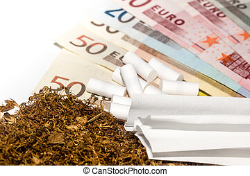 Tobacco, carbon filters, paper against the background of money