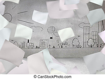 White paper in front of grey wall with cityscape