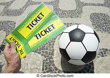 Soccer fan holds football tickets - Hand holds two handmade...