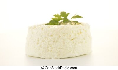 Cottage cheese with parsley leaf rotating on white...