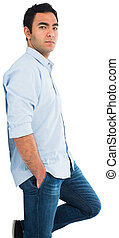 Unsmiling casual man standing