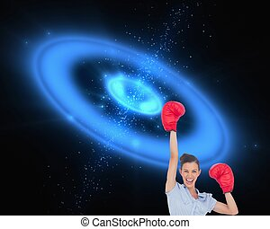 Businesswoman cheering wearing boxing gloves