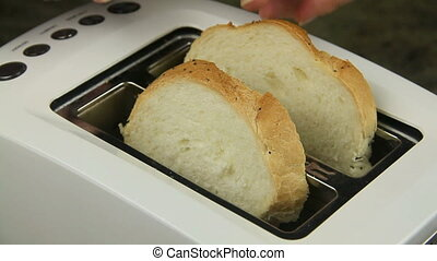 Toasting White Bread - Two slices of bread put in a toaster...