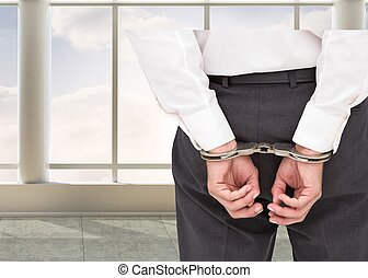 Close up on classy businessman wearing handcuffs - Composite...
