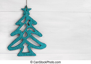 blue shine christmas tree on white wooden background with...