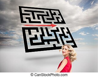 Smiling blonde in red dress twirling - Composite image of...
