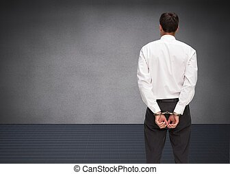 Rear view of young businessman wear - Composite image of...