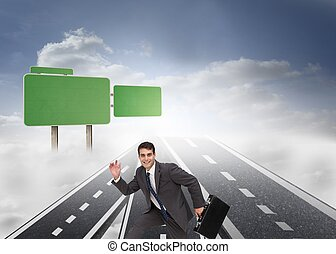 Happy businessman holding a briefcase and running -...
