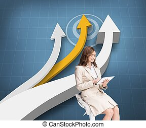 Pleased businesswoman using a table - Composite image of...