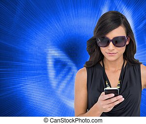 Concentrated brunette wearing sunglasses texting - Composite...