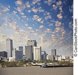 New Orleans, Louisiana. Mississippi river and beautiful city skyline at sunset.