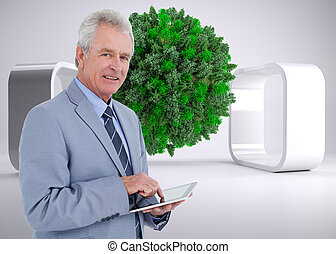 Composite image of side view of mature tradesman with tablet...