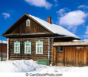 Old wooden house - Typical Russian house: a wooden hut. Made...