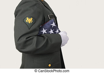 Military Honor - US Army soldier holding USA flag