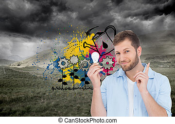 Composite image of charming model holding a bulb in right...