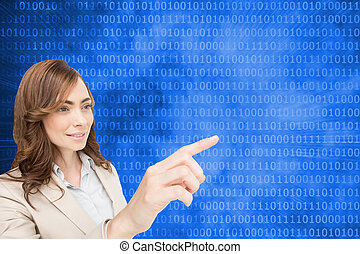 Composite image of businesswoman pressing an invisible key