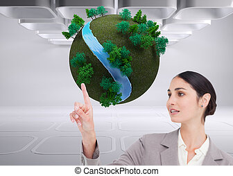 Composite image of young saleswoman operating touchscreen...