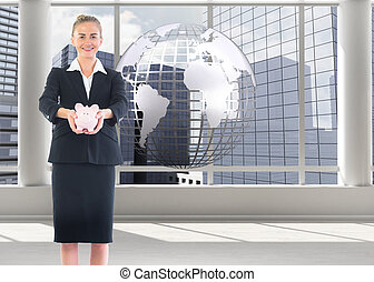 Composite image of happy businesswoman holding a piggy bank...