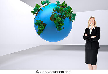 Composite image of a confident businesswoman with folded arms against white background
